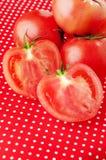 Tomato on a dot table cloth Stock Photos