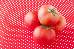 Tomato on a dot table cloth Stock Photo