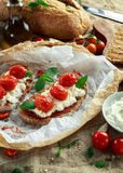 Tomato Ricotta Bruschetta with sun dried tomatoes paste, olive oil brown bread and basil Royalty Free Stock Images