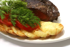 Tomato and roast beef. Sliced roast meat and tomato on dish Stock Images