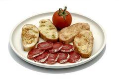 Tomato rubbed on a slice of bread Stock Photo