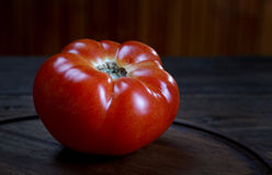 Tomato on a rustic  table Stock Photos