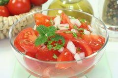 Tomato salad. With fresh herbs royalty free stock photos