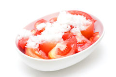 Tomato salad. In a white oval bowl and covered by sugar stock photos