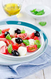 Tomato salad. With mozzarella and basil Stock Photography