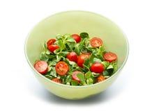 Tomato salad. Tomatos and corn salad isolated on white background Royalty Free Stock Photo