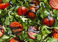 Tomato salad. Cherry tomatos and corn salad as background Stock Images