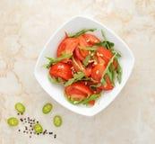Tomato salad with arugula stock photo