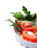 Tomato salad with arugula in a white cup Royalty Free Stock Images