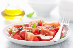Tomato salad with basil dressing Stock Photos