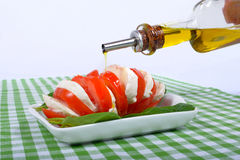 Tomato salad with bottle of olive oil Royalty Free Stock Photo