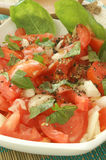 tomato salad in bowl with onion and basil Stock Image