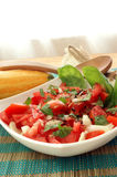tomato salad in bowl with onion and basil Stock Photo