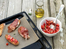 Tomato salad with bread, proscuitto, olive oil Stock Images