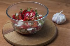 Tomato salad with cabbage in a glass bowl stock photos