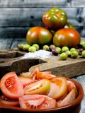 Tomato salad dressed with extra virgin olive oil Stock Photography