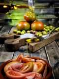 Tomato salad dressed with extra virgin olive oil Stock Images