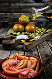 Tomato salad dressed with extra virgin olive oil Royalty Free Stock Photography