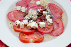 Tomato salad. A tomato and feta cheese salad Royalty Free Stock Image