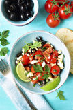 Tomato salad with feta cheese and olive. Stock Photos