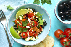 Tomato salad with feta cheese and olive. Royalty Free Stock Photo