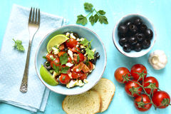 Tomato salad with feta cheese and olive. Stock Photo