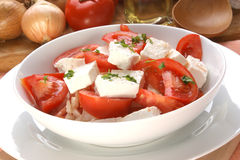 Tomato salad with feta cheese and parsley Royalty Free Stock Photos
