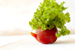 Tomato with salad. Royalty Free Stock Image