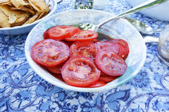 Tomato Salad. Fresh sliced tomatoes against an attractive Batik tablecloth Royalty Free Stock Image