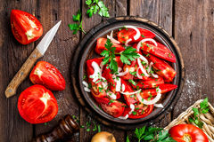 Tomato salad. Fresh tomatoes, onion and parsley Stock Images