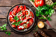 Tomato salad. Fresh tomatoes, onion and parsley Stock Photos