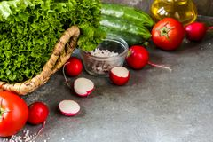 Tomato salad and fresh vegetables and herbs for cooking. Selective focus Royalty Free Stock Images