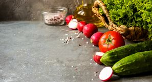 Tomato salad and fresh vegetables and herbs for cooking. Selective focus Royalty Free Stock Photo