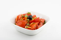 Tomato salad. Front view. Selective Focus. White background royalty free stock photo