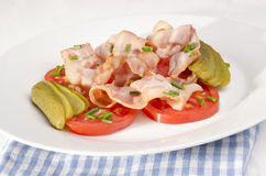 Tomato salad with grilled bacon Royalty Free Stock Image