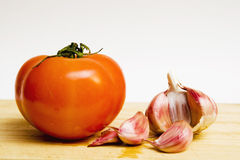 Tomato salad and head of garlic Stock Image