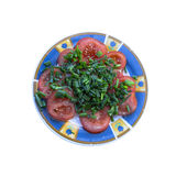 Tomato salad. Isolated tomato salad with green chives Royalty Free Stock Photo