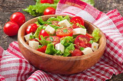 Tomato salad with lettuce, cheese Royalty Free Stock Photos