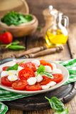 Tomato salad with mozzarella cheese and olive oil. Italian cuisine Royalty Free Stock Image