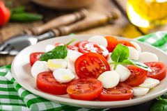 Tomato salad with mozzarella cheese and olive oil. Italian cuisine Royalty Free Stock Photo