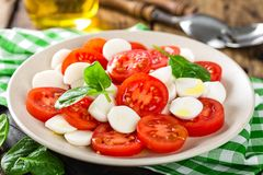 Tomato salad with mozzarella cheese and olive oil. Italian cuisine Stock Images