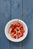 Tomato salad with onion in bowl Royalty Free Stock Photo