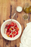 Tomato salad with onion in bowl Royalty Free Stock Images