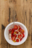 Tomato salad with onion in bowl Royalty Free Stock Image