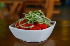 Tomato salad with onions royalty free stock image