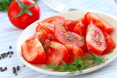 Tomato salad with pepper and greens Royalty Free Stock Image