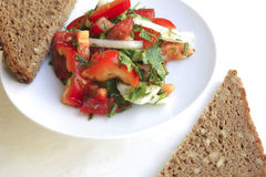 Tomato salad and rye bread Royalty Free Stock Images
