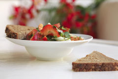 Tomato salad and rye bread Stock Image