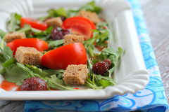 Tomato salad, strawberries, arugula, croutons Royalty Free Stock Photography