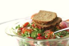 Tomato salad on white table Royalty Free Stock Photo